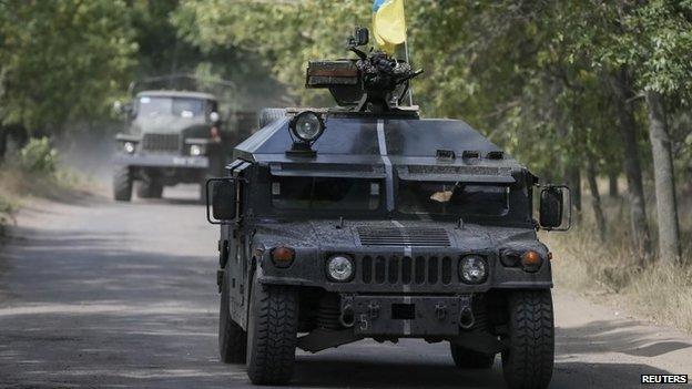Ukrainian servicemen ride in an armoured vehicle in Kramatorsk - 1 September 2014
