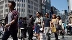 Pedestrians walk in Tokyo's Ginza shopping district