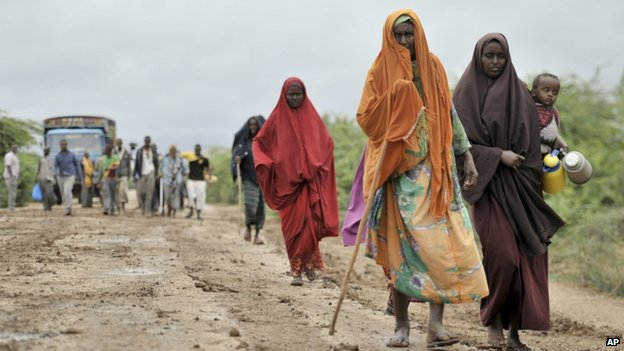 Civilians who had left the town of Bulomarer when it was held by al-Shabab militants, return following the town's capture by African Union (AU) and Somali government soldiers (1 September 2014)
