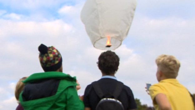 Children letting off Chinese lantern