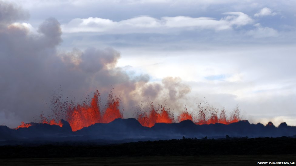 A plume of smoke rises from the lava eruption on Holuhraun