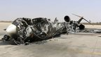 A wreckage of a burnt aircraft is pictured after a shelling at Tripoli International Airport