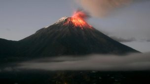 Picture f the Tungurahua volcano spewing smoke and flames taken on 31 August, 2014, from Banos,