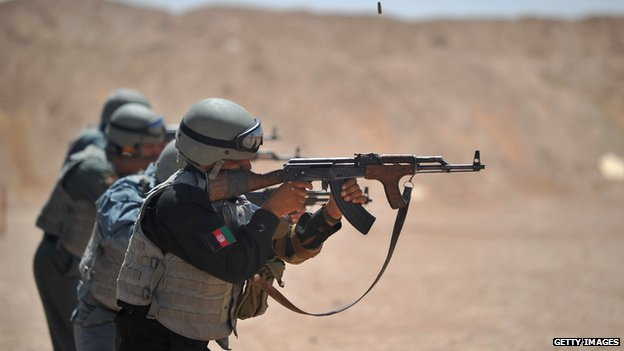 Members of the Afghanistan National Policemen (ANP) fire their AK47 rifles during shooting course taught by US Marines at Camp Leatherneck in Helmand Province on 19 June 2012.