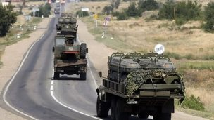 Russian military vehicles drive along the road outside Kamensk-Shakhtinsky, Rostov region, Russia, 16 August 2014