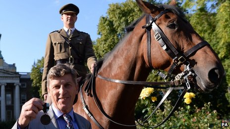 "Brough Scott, grandson of Warrior""s owner and rider General Jack Seely, with the Honorary PDSA Dickin Medal"