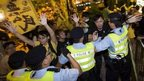 Pro-democracy activists clash with the police during a protest outside the hotel where China's National People's Congress (NPC) Standing Committee Deputy General Secretary Li Fei is staying, in Hong Kong, 1 September 2014