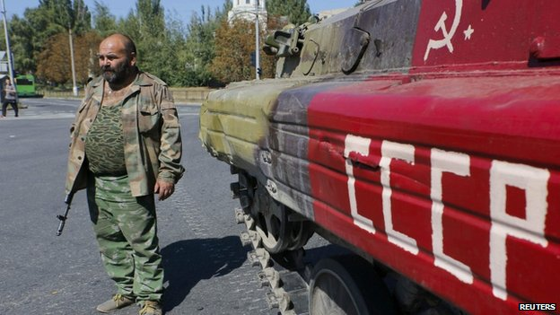 Pro-Russian rebel in Donetsk with armoured vehicle with USSR written on side