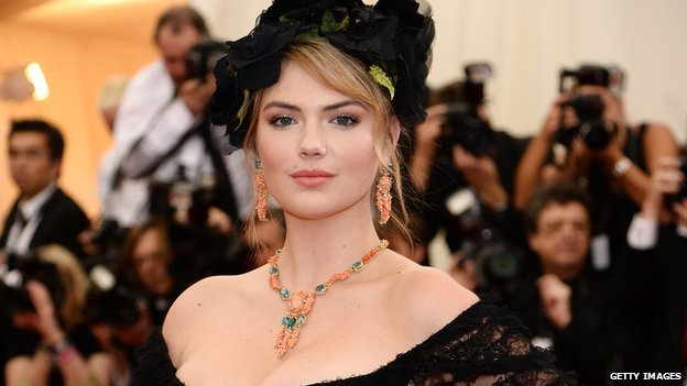 Model Kate Upton stands on a red carpet in New York on 5 May, 2014.