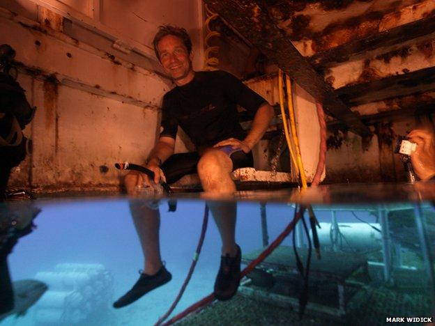 Fabien Cousteau sits in the wet porch