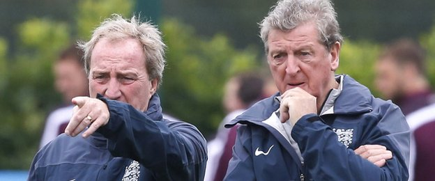 England manager Roy Hodgson and assistant Ray Lewington (L) cast their eye over a training session