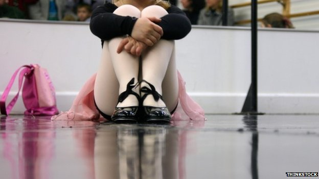 Child sitting in tap class
