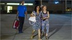 Brett and Naghemeh King, centre and left, leave Soto Del Real prison in Madrid, Spain, Tuesday, Sept. 2, 2014