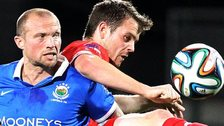 Linfield player-manager Warren Feeney battle against Jamie McGovern of Cliftonville