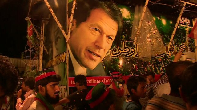 Imran Khan's face on the side of a vehicle at the protest