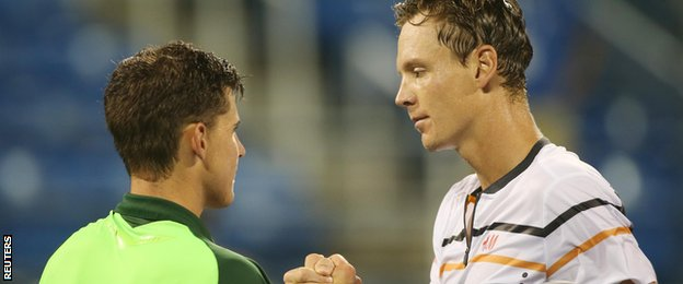 Dominic Thiem shakes hands with Tomas Berdych