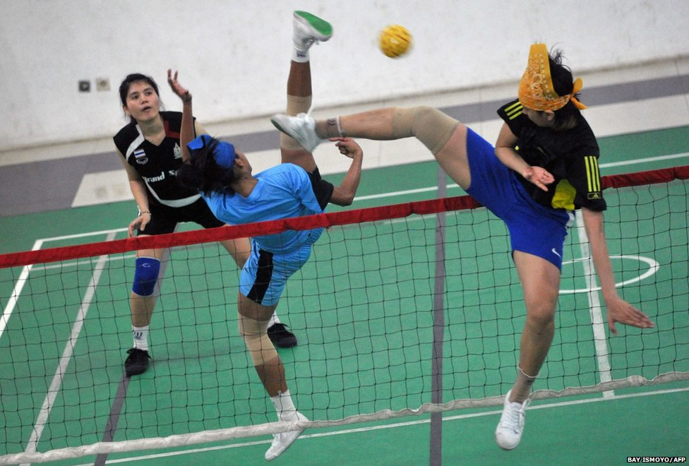 Indonesian sepak takraw players take part in a practice session in Jakarta