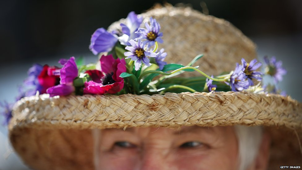 Exhibitor Penny Cunnington wears a floral display in her hat