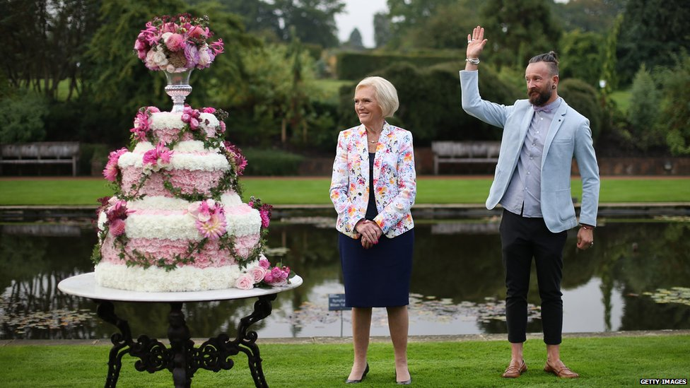 Mary Berry stands with floral decorator Simon Lycett