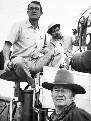 Director Andrew McLaglen (left) on the set of 1969 film Undefeated, starring John Wayne