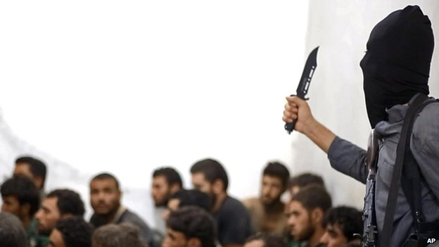 An undated photograph shows an Islamic State militant holding a knife.