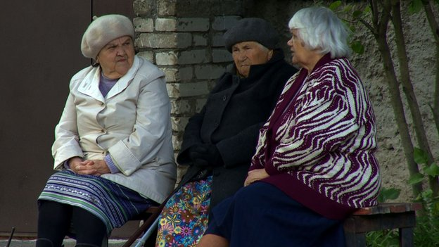 Yevgenia and two friends sitting on a bench near the Narva River - 2 September 2014