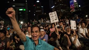 Protesters take part in the rally for the beginning of Occupy Central movement outside Central Government Offices in Central, Hong Kong on 31 August 2014