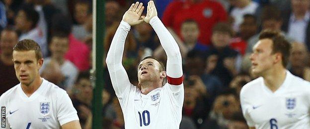 England captain Wayne Rooney (centre)