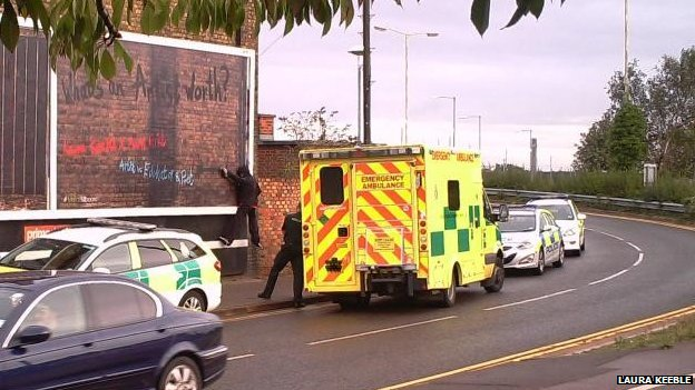 Emergency services and billboard art in Peterborough