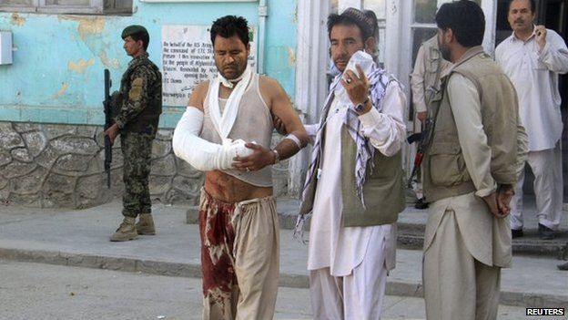 An Afghan man walks outside after receiving treatment at a hospital after a suicide bomb attack in Ghazni Province, on 4 September 2014.