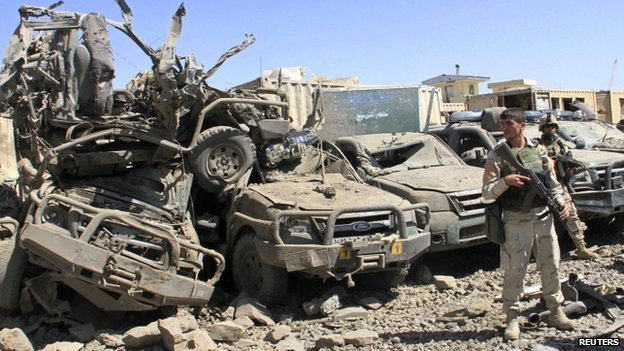 Members of the Afghan security force keep watch at the site of a suicide bomb attack in Ghazni Province 4 September 2014.
