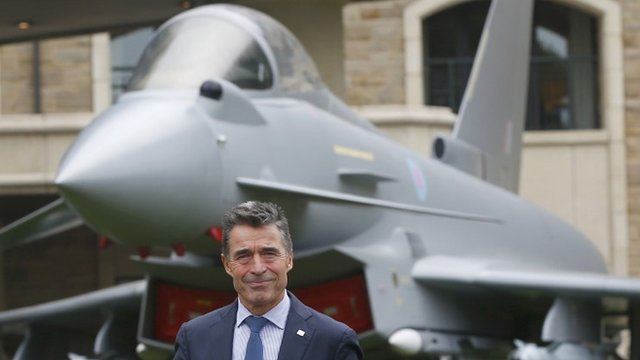 NATO Secretary-General Anders Fogh Rasmussen prepares to speak to the media at the Celtic Manor resort, near Newport, in Wales September 4, 2014