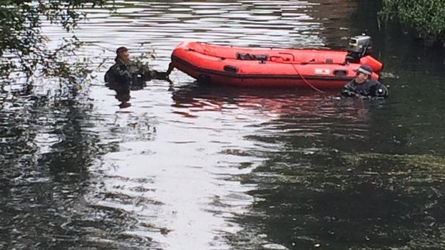 Police diver searching River Brent