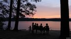 Friends enjoying the sunset over Pog Lake
