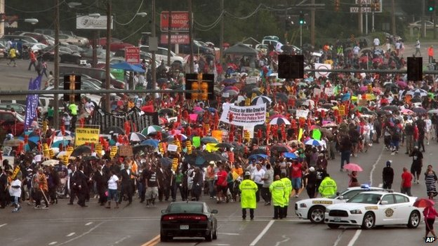 Thousands of people march south on West Florissant Avenue during a rally in Ferguson, Missouri 30 August 2014