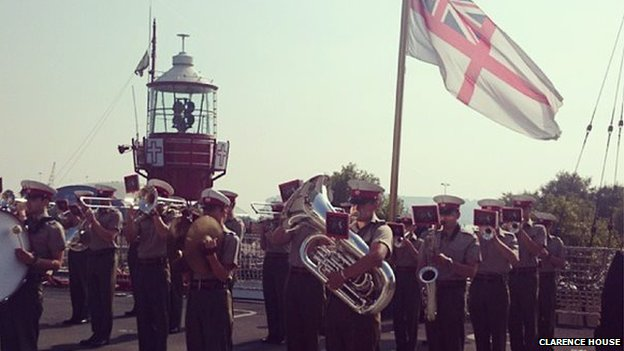The military band entertained the crowds