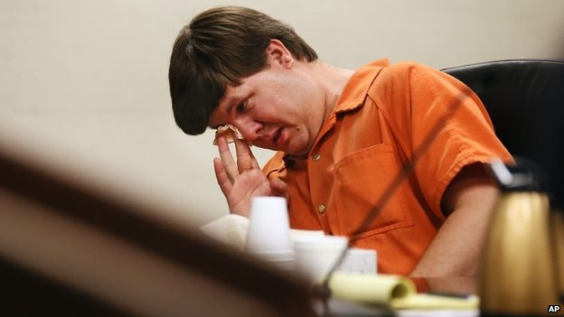 Justin Ross Harris, the father of a toddler who died after police say he was left in a hot car for about seven hours, wipes his eye as he sits during his bond hearing in Cobb County Magistrate Court, 3 July 2014