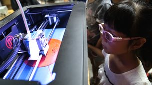 Chinese girl learning how to use a 3-D printer in a workshop at Creatica in Beijing