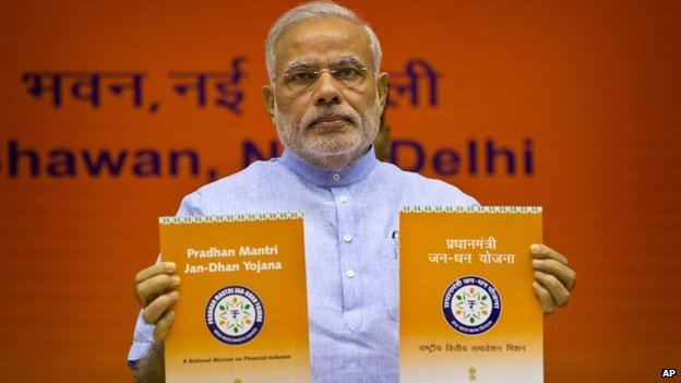 PM Narendra Modi unveils the logo of a campaign aimed at opening millions of accounts for poor Indians in Delhi on Thursday, Aug. 28, 2014