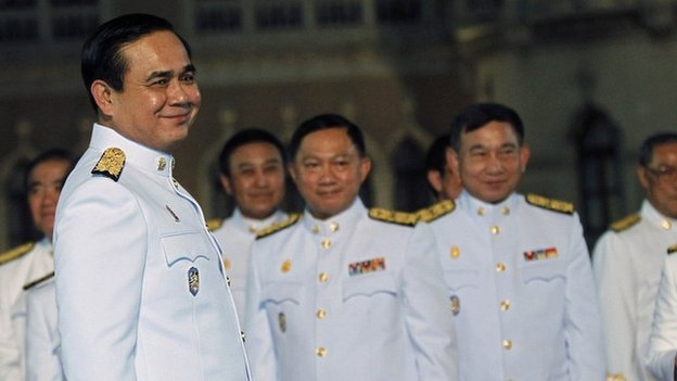 Thai Prime Minister Gen Prayuth Chan-ocha (left) with other officers after an audience with King Bhumibol