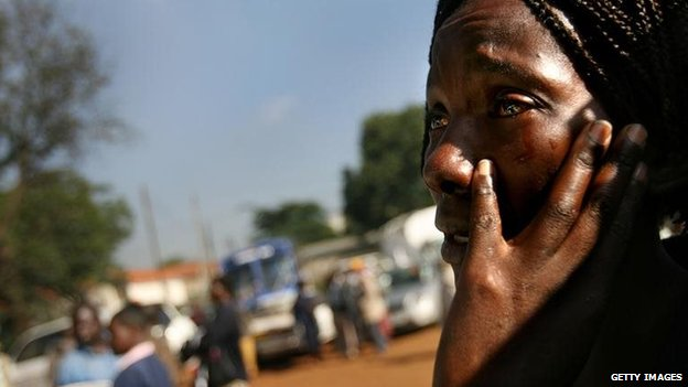 A Kenyan woman cries before a mass funeral for victims of clashes on January 23, 2008 in Nairobi, Kenya