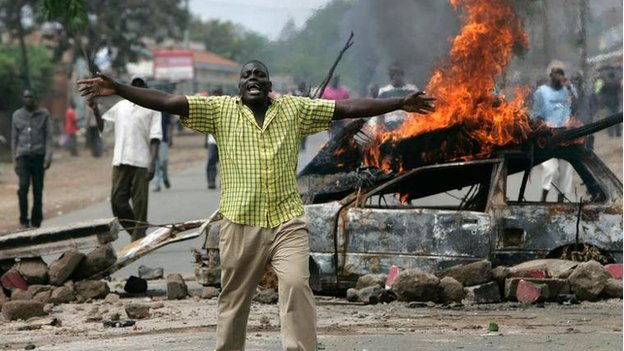 Opposition party supporters chant their grievances near to a burning barricade, in Kisumu, western Kenya, Wednesday, Jan. 16, 2008,