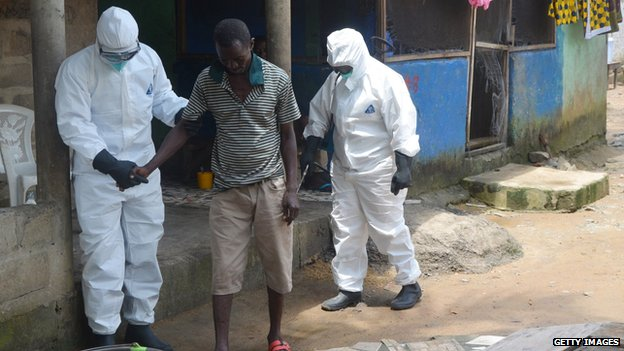 Nurses helping man with Ebola