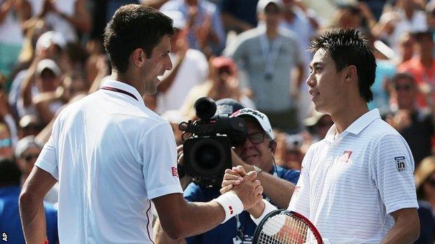 Novak Djokovic congratulates Kei Nishikori