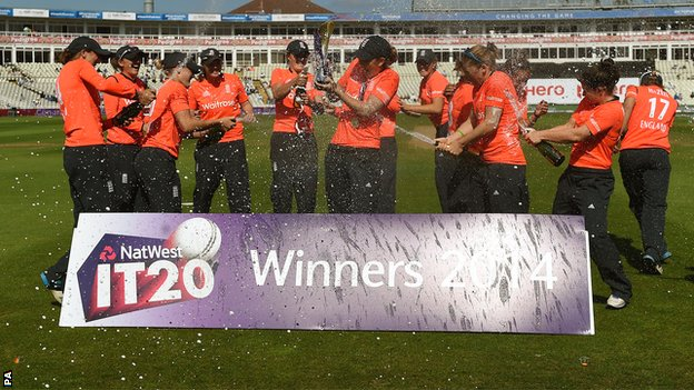 England spray each other with champagne after winning the T20 series