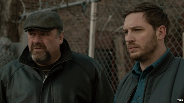 Still from The Drop showing Gandolfini and Hardy