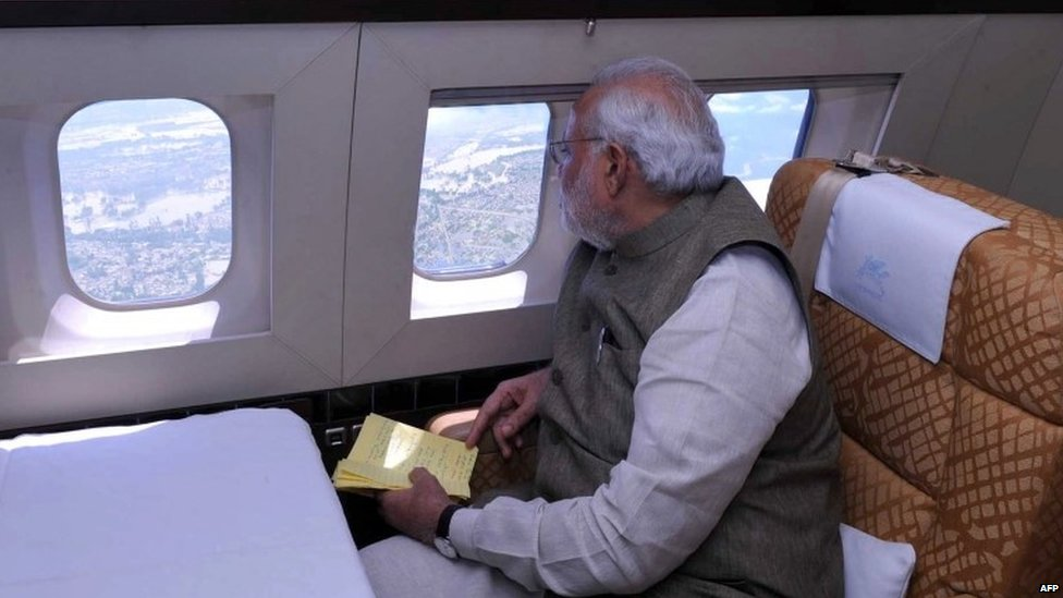 Indian Prime Minister Narendra Modi looks over a flood-affected area from an aeroplane during a visit to the state of Jammu and Kashmir.