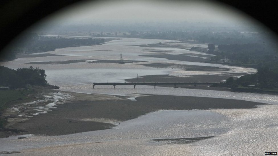 An aerial view taken from the Indian Air Force's helicopter shows a damaged bridge which was swept away by floods on the river Tawi in the outskirts of Jammu September 7, 2014