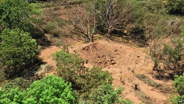Picture shows an impact crater made by a small meteorite in a wooded area near Managua's international airport.