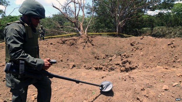A Nicaraguan soldier checks the site where a meteorite struck on 7 September, 2014 in Managua.